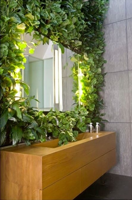 a living wall with a sink next to it will make you feel washing outdoors