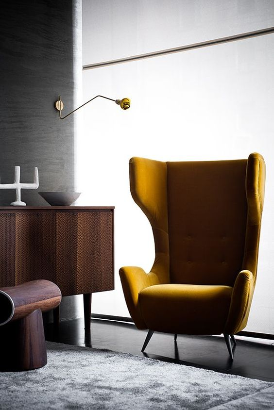 a mustard velvet wingback styled as in the 1950s is ideal for a mid-century modern space