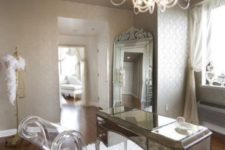 24 a refined girl's home office with a gorgeous silver frame mirror and acrylic pieces