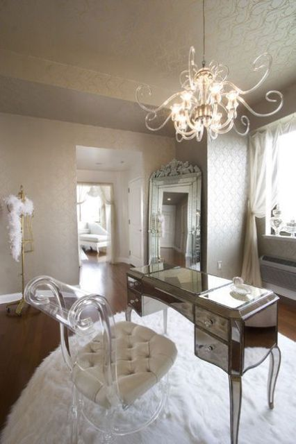 a refined girl's home office with a gorgeous silver frame mirror and acrylic pieces