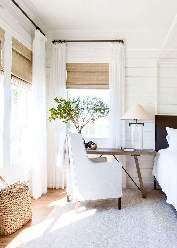 sheer white curtains plus textural Roman shades for a more rustic feel in a farmhouse space