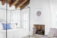25 a rustic ceiling of weathered wood with beams makes this cozy country-styled bedroom complete