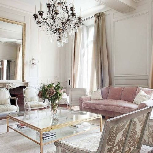 a vintage chandelier and some refined chairs create a fantastic ambience
