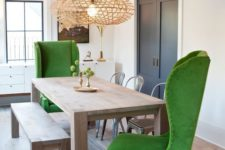 25 modern green wingback chairs and a simple wooden dining set contrast creating a unique look