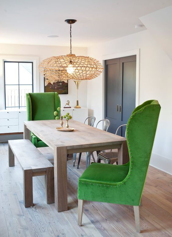 modern green wingback chairs and a simple wooden dining set contrast creating a unique look