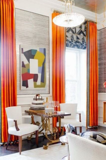 spruce your home with bold curtains like here, orange draperies and geometric print Roman shades