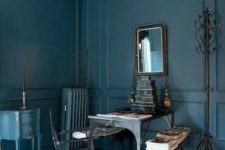 26 a moody masculine office with a vintage-framed mirror to enliven the space