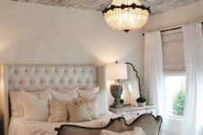 26 a rustic shabby chic wooden ceiling of reclaimed wood adds texture and interest