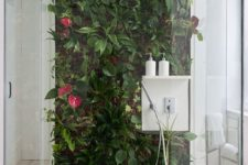 26 a tropical living wall with flowers right in the shower will make you feel outdoors