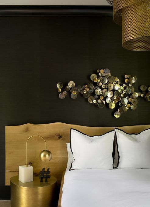 an amazing shiny metal wall sculpture adds a refined touch to the space