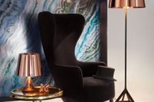 26 an elegant take on a wingback, a black velvet chair with chic lines and shapes