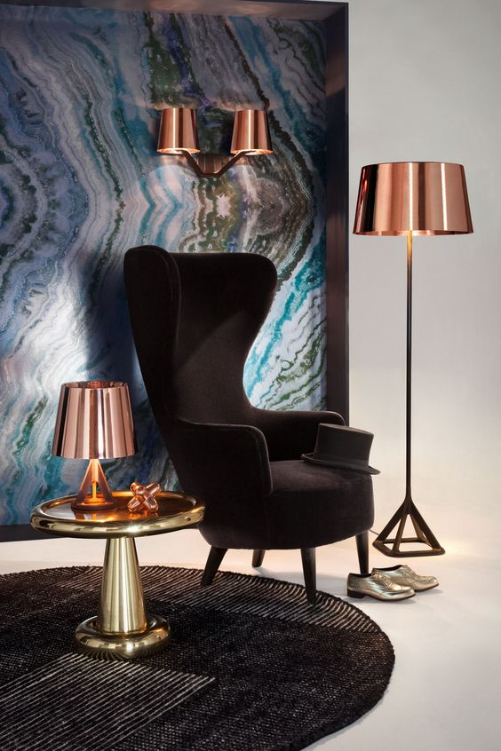 an elegant take on a wingback, a black velvet chair with chic lines and shapes