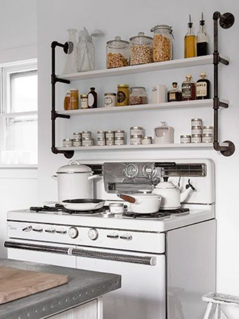 open shelving highlighted with metal tubing of a different color to make it a part of decor