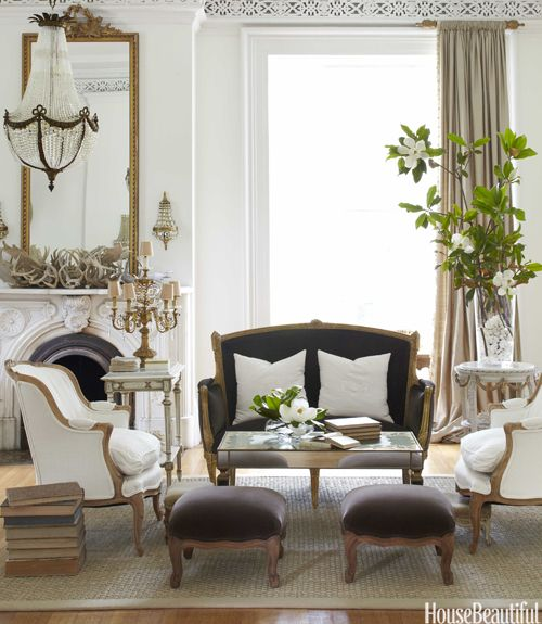 refined vintage upholstered furniture and a matching mirror for a Parisian living room