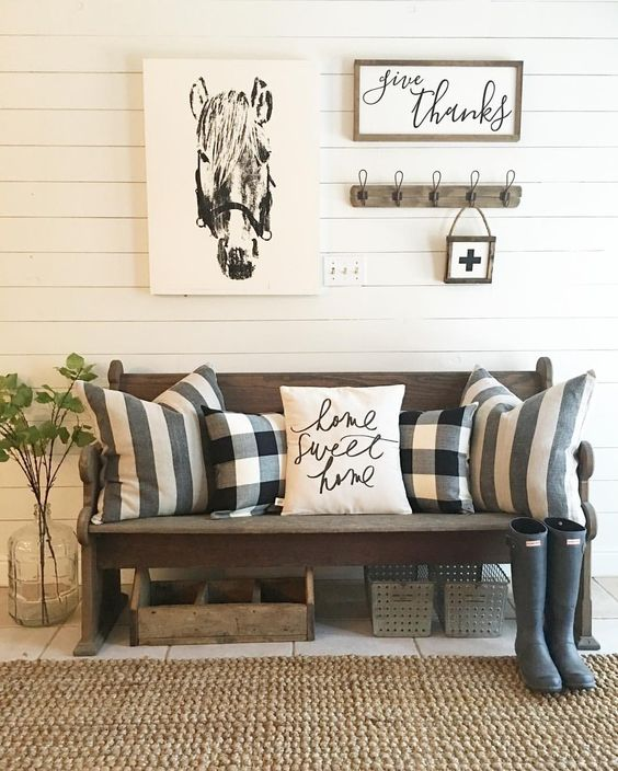 some buffalo check pillows are a great idea to style a rustic entryway