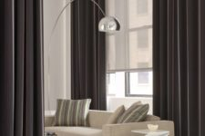 26 stylish black curtains and an additional semi sheer Roman shade to hide from the sun
