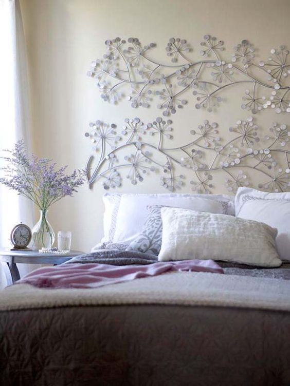 a gorgeous metal florla-inspired screen is a wonderful idea for a girl's bedroom
