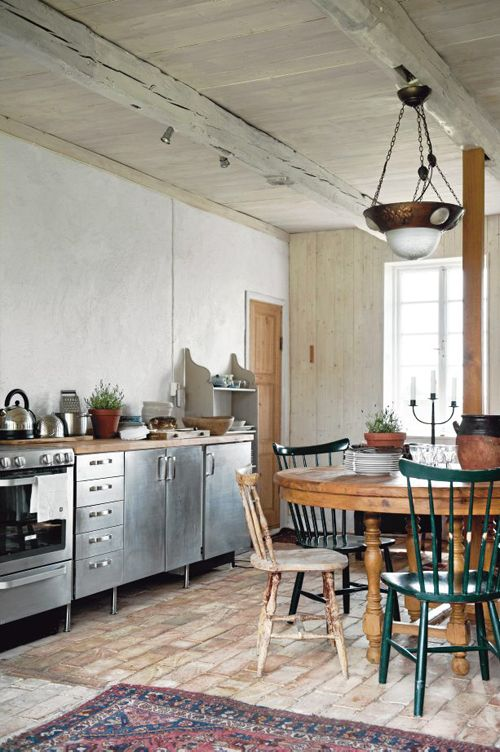 a rustic farmhouse kitchen with freestanding metal cabinets and wooden counters for a softer feel