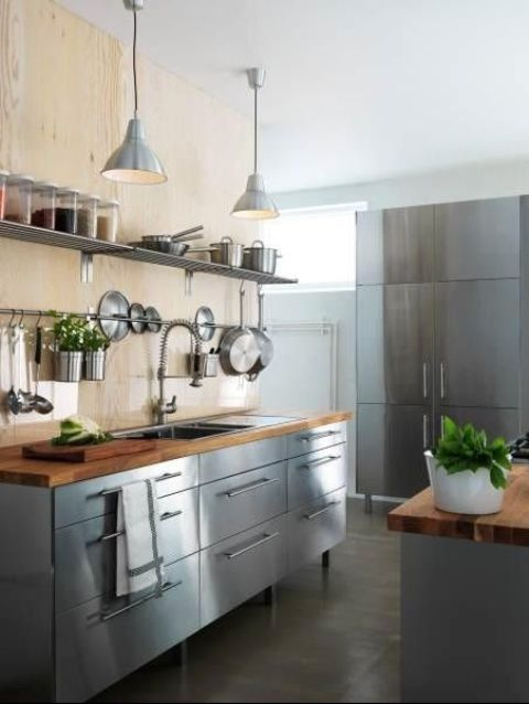 freestanding stainless steel kitchen cabinets with wooden countertops create a cool industrial look