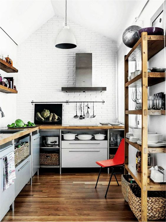 grey kitchen cabinets with metal legs and wooden countertops for a bold and modern kitchen with an industrial feel