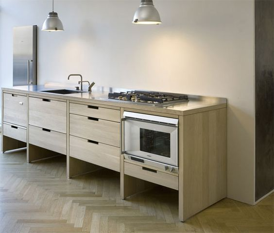 minimalist kitchen cabinets on tall legs make cleaning the floors easier
