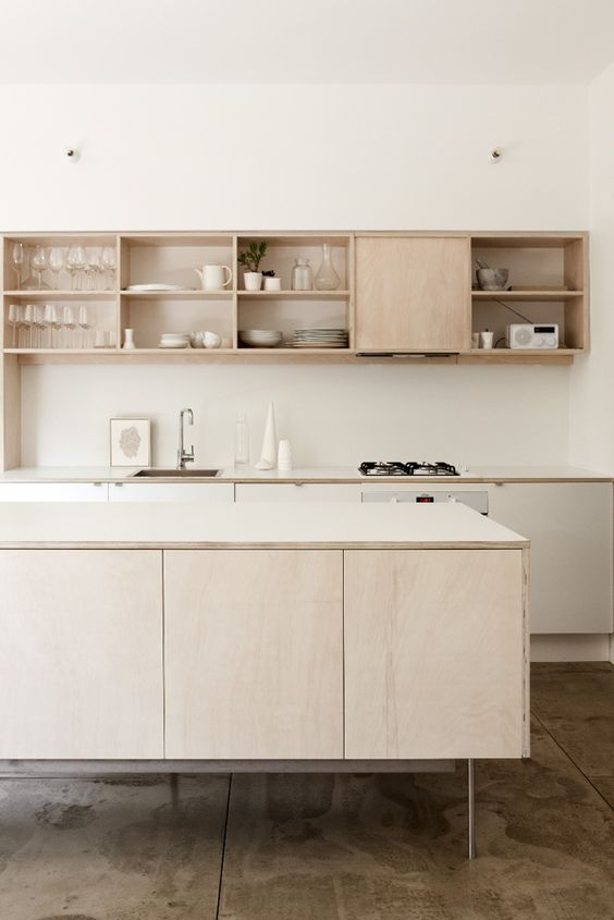 modern light-colored kitchen cabinets on tall thin metal legs for a contemporary and airy feel