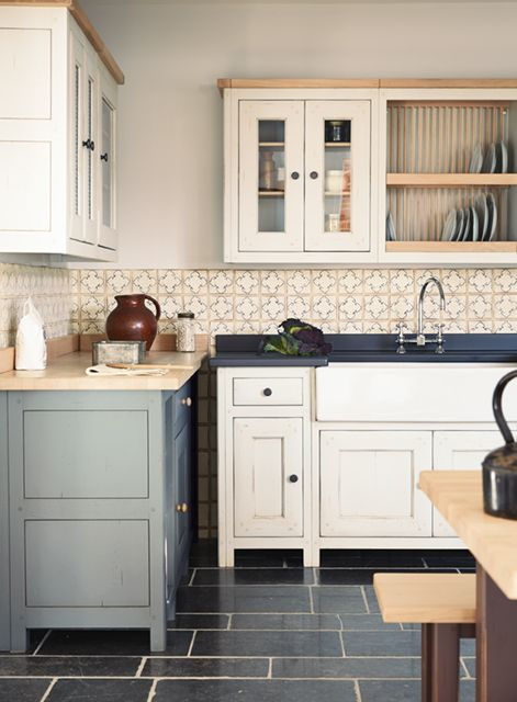 vintage creamy and grey freestanding kitchen cabinets for a contrasting and bold space