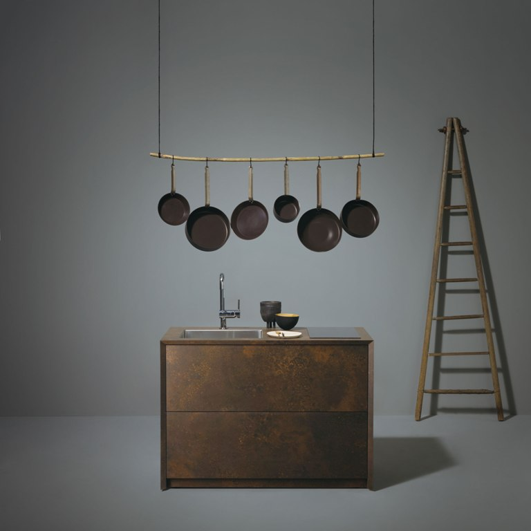 Ceragino kitchen is done with an oxidized metal finish and features an additional shelf