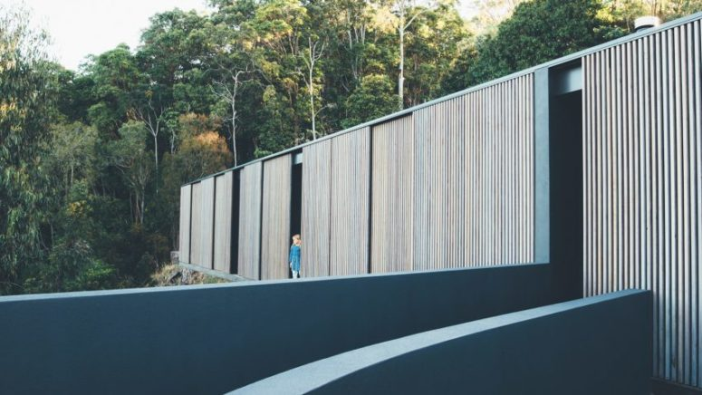 This Australian home is fully clad with timber screens that protect the house from excessive sunlight