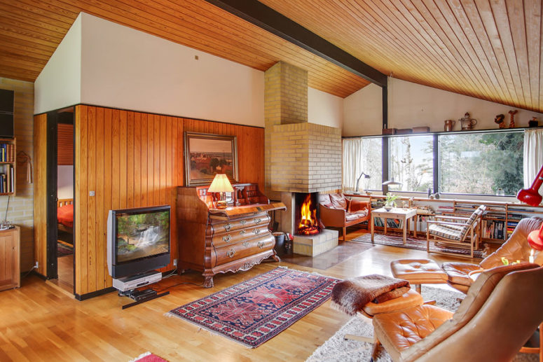 This home is mid century modern, with vintage Danish furniture and much honey colored wood in decor