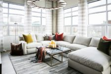 02 Large windows bring much light inside, and a large corner sofa with a double upholstered bench creates a cozy space