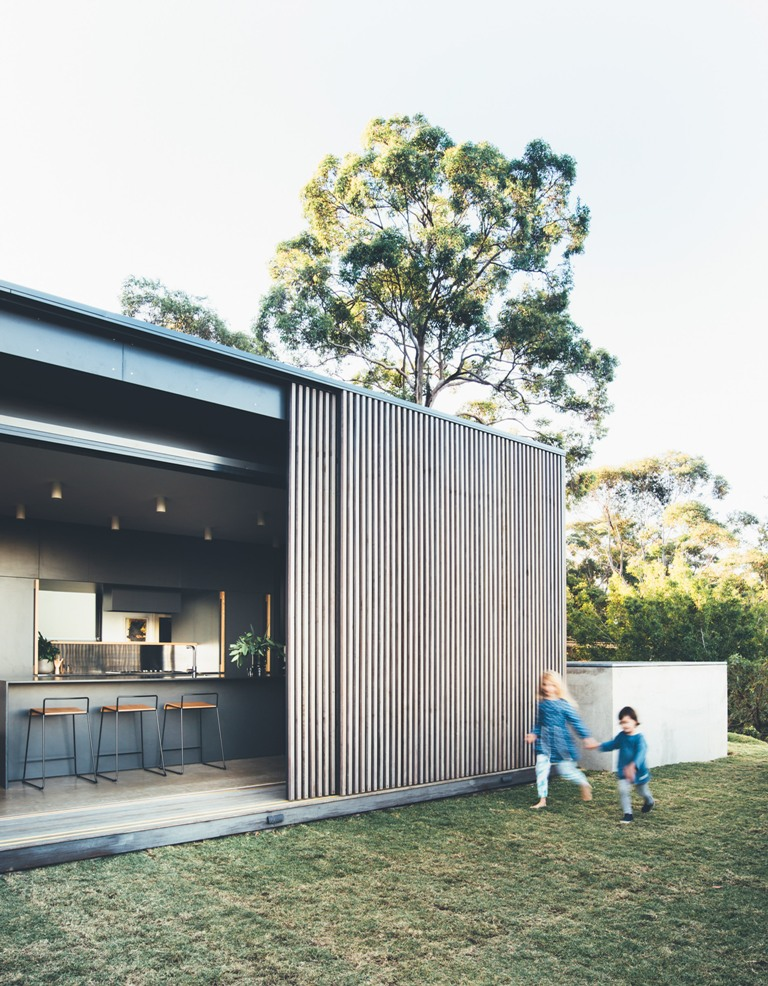 The screens can be pulled out to enjoy the views of the eucalyptus forests and ocean from the house