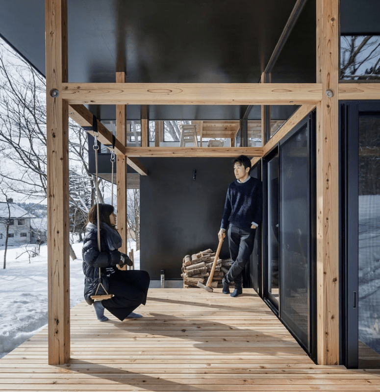 There are outdoor decks with firewood storage and a swing