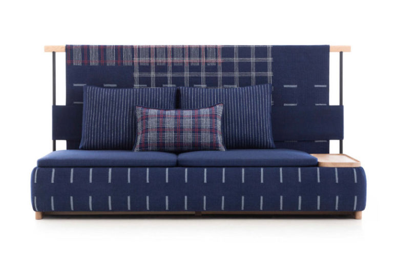 This is a sofa with lots of cushions, plaid prints and a cool look - it's ideal for a modern dynamic space