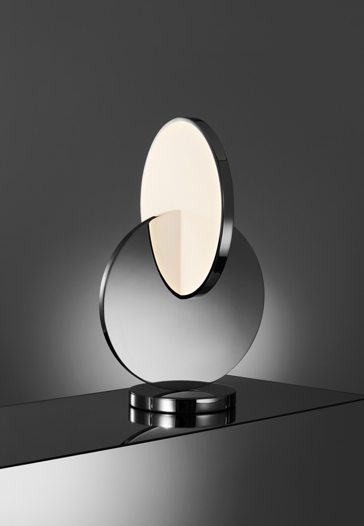 Tidal is a table lamp formed from polished chrome and acrylic with LED lights
