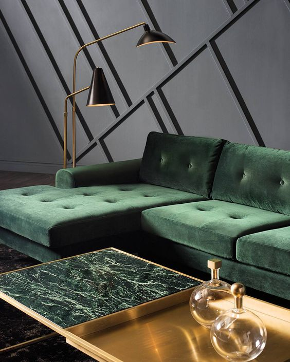 a half brass and half green marble coffee table brings a refined and chic touch to the living room