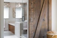 02 a modern space features sliding barn doors of reclaimed wood that make a bold rustic statement