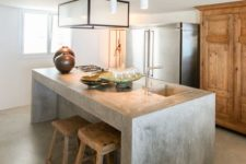 02 a simple concrete kitchen island with a breakfast space is also an industrial idea but brings a modern vibe