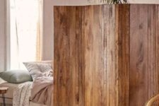 02 a stained reclaimed wooden screens is a cool idea to separate a studio apartment