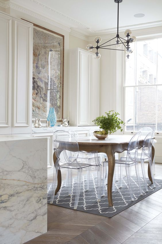 A Vintage Dining Table And Clear Ghost Acrylic Chairs That Donu0027t Distract  Attention From