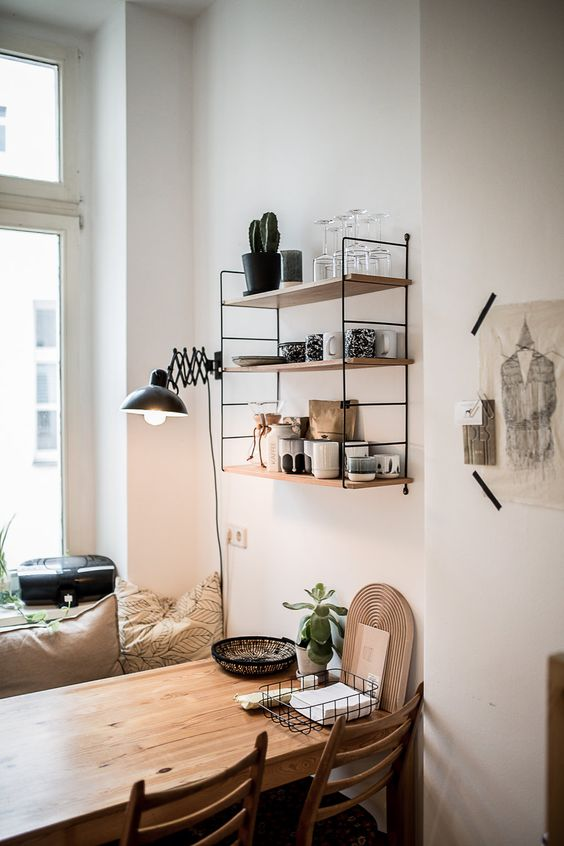 hang an open shelf that matches in over the dining space, it won't look bulky