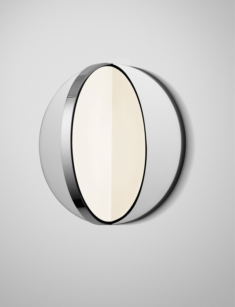 Eclipse is a wall lamp that reminds of Tidal and looks like a real eclipse