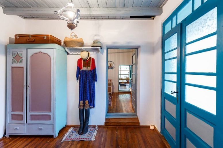 Some furniture was restored like this wardrobe, and the owner added some colorful touches to it