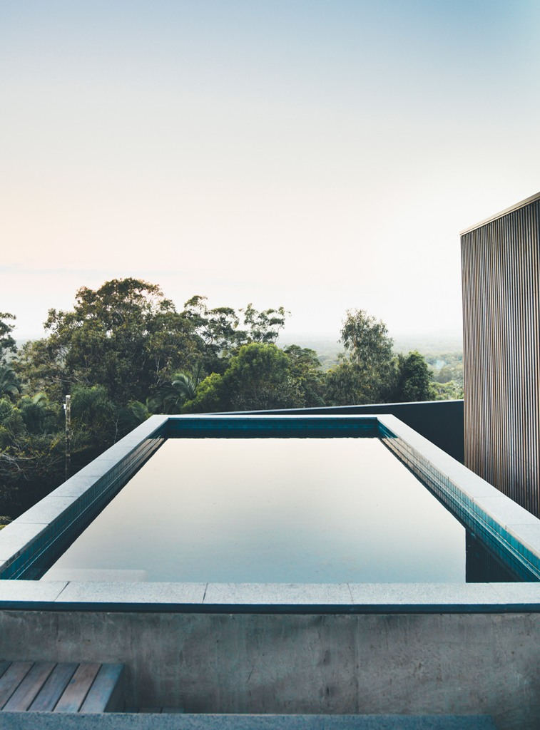 There's an outdoor pool that seems to be going right to the forest