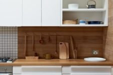 03 a bold contemporary kitchen with white cabinets and touches of light-colored wood for a natural feel