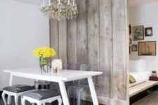 03 a rustic grey wooden screen makes the sleeping space more private and adds coziness to the shabby chic space