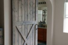 03 a sliding barn door on black metal adds coziness and warmth that only a barn piece can bring
