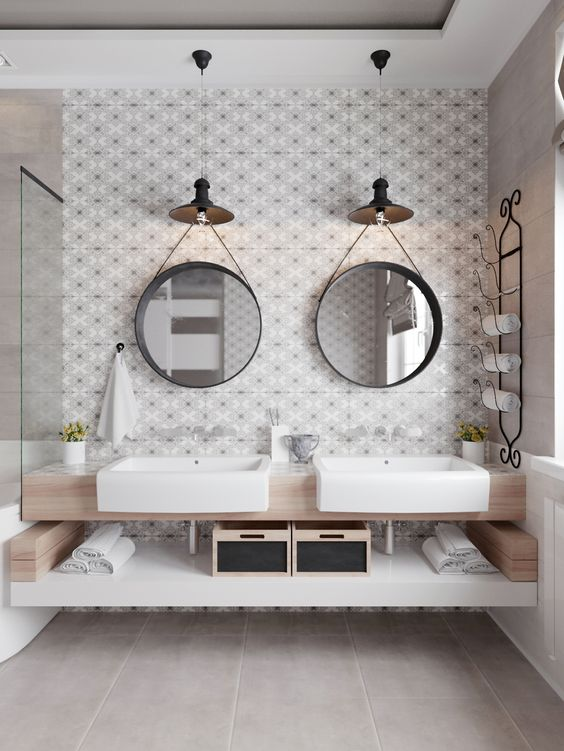 every mirror features a lamp, which is used as an accent and maybe task light, too