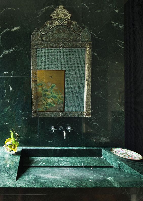 fabulous green marble sink with a minimalist design and matching green marble tiles for a stunning bathroom