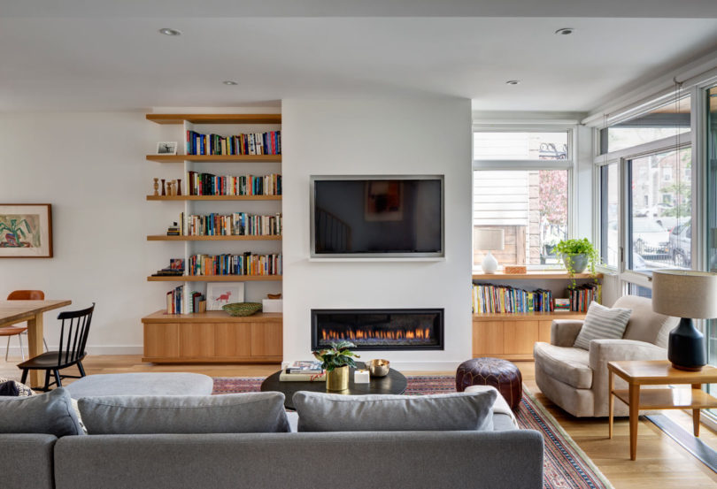A built in fireplace adds coziness and there's a comfy reading nook by the window